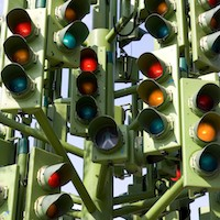 Multiple traffic lights on green amber and red